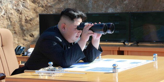 North Korean Leader Kim Jong Un looks on during the test-fire of inter-continental ballistic missile...