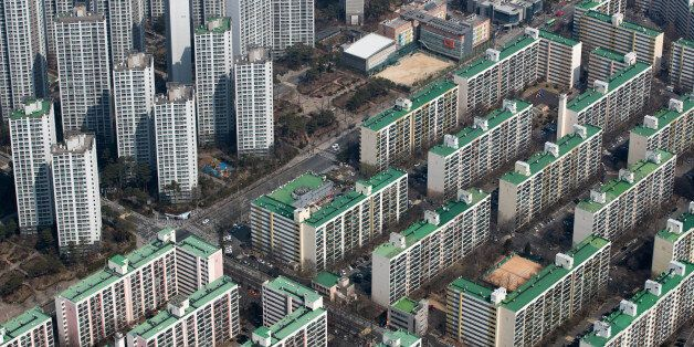 Residential apartment buildings are seen from the observation deck of the Lotte Corp. World Tower in...