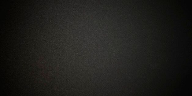Close-up of a black paper texture background with
