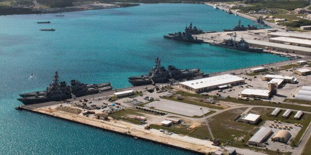 FILE PHOTO: Navy vessels are moored in port at the U.S. Naval Base Guam at Apra Harbor, Guam March 5,...