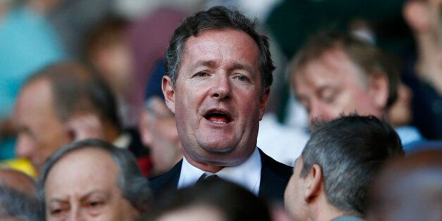 Former newspaper editor Piers Morgan takes his seat in the stand before Arsenal play Tottenham Hotspur...