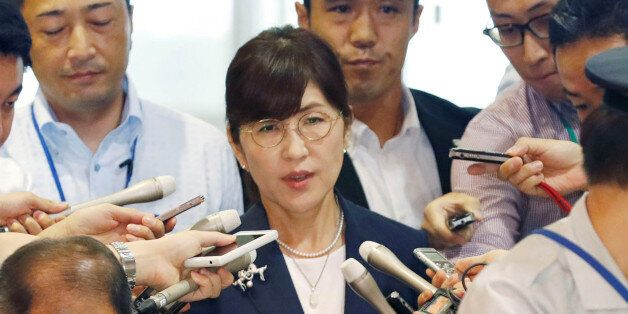 Japan's Defence Minister Tomomi Inada is surrounded by reporters as she arrives at Defence Ministry in...