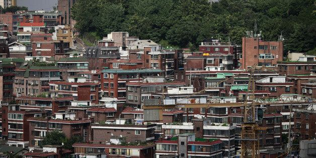 Residential buildings stand in the district of Mapo in Seoul, South Korea, on Wednesday, July 24, 2013....