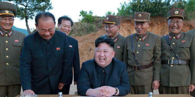 FILE PHOTO - North Korean leader Kim Jong Un reacts during the long-range strategic ballistic rocket...