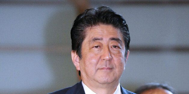 Japan's Prime Minister Shinzo Abe arrives at his official residence in Tokyo on August 15, 2017.Abe sent...