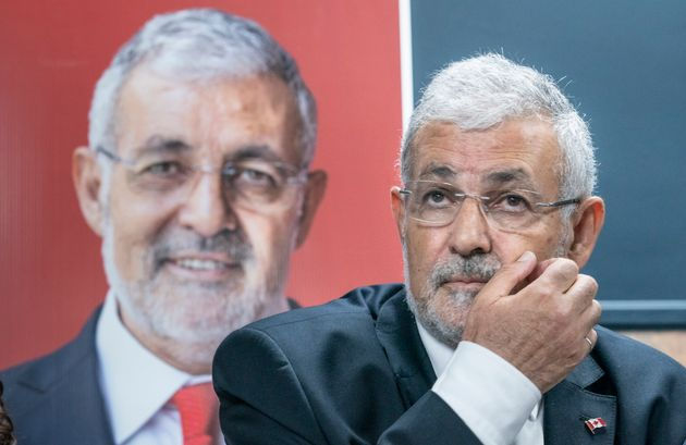 ImamHassanGuillet, who has been dropped by the Liberal party as a candidate, listens to a...