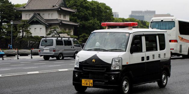 A police car of Suzuki Motor - Every, drives past the Imperial Palace in Tokyo, Japan June 1, 2017. REUTERS/Toru