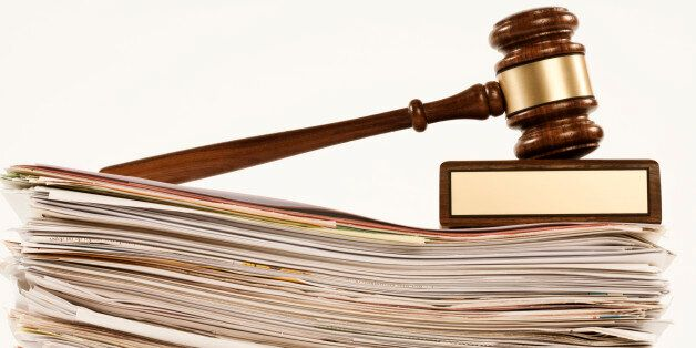 gavel on stack of documents on white