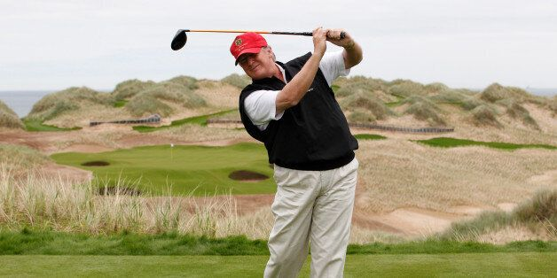 U.S. property magnate Donald Trump practices his swing at the 13th tee of his new Trump International...