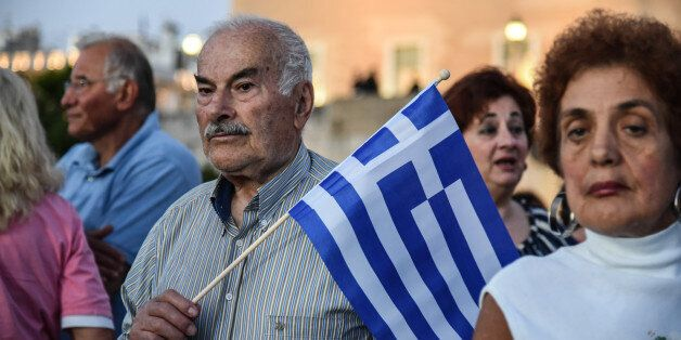 Greeks attending an anti government rally organized by the mostly conservative Resign movement at Syntagma...