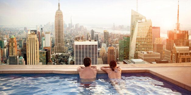 Couple relaxing in swimming pool on hotel