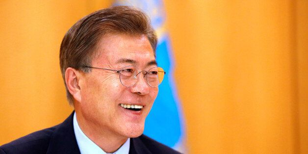 South Korean President Moon Jae-in speaks during an interview with Reuters at the Presidential Blue House...