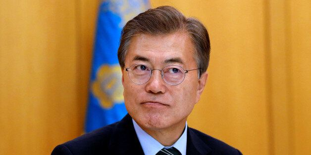South Korean President Moon Jae-in looks on, during an interview with Reuters, at the Presidential Blue...