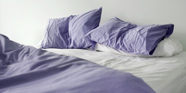 Un made bed in the