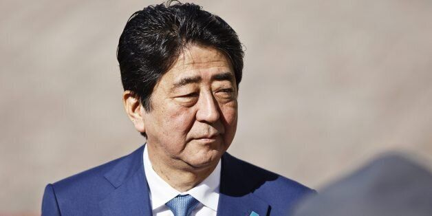 Japanese Prime Minister Shinzo Abe arrives for a welcoming ceremony in front of the Presidential Palace...