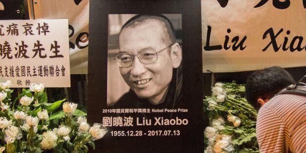 HONG KONG, CHINA - JU;Y 13: Residents of Hong Kong host a vigil service outside the Chinese Liason Office...