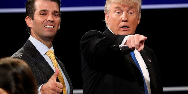 Donald Trump Jr. (L) gives a thumbs up beside his father Republican U.S. presidential nominee Donald...
