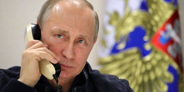 Russian President Vladimir Putin speaks by phone with his Turkish counterpart from aboard the Pioneering...