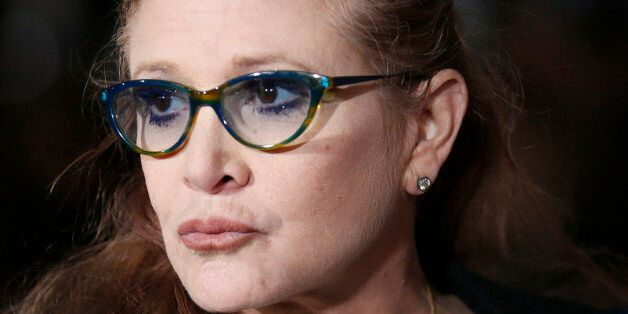 Actress Carrie Fisher poses at the world premiere of the