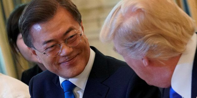 U.S. President Donald Trump shakes hands with South Korean President Moon Jae-in during a dinner in the...