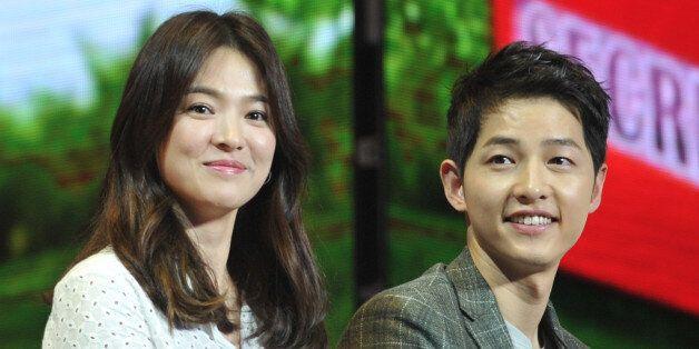 CHENGDU, CHINA - JUNE 17: (CHINA OUT) South Korea actress Song Hye Kyo and actor Song Joong-ki attend...