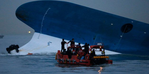 Maritime police search for missing passengers in front of the South Korean