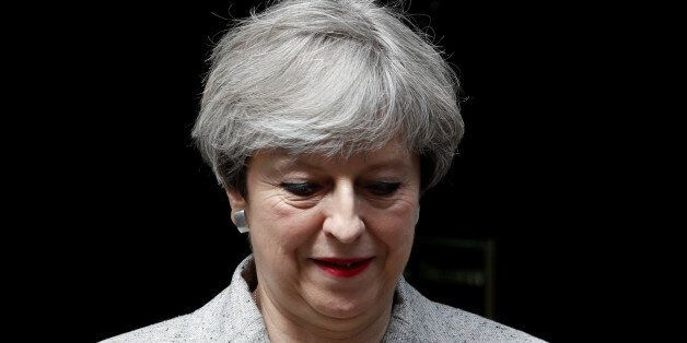 Britain's Prime Minister Theresa May, leaves 10 Downing Street in central London, Britain June 13, 2017....
