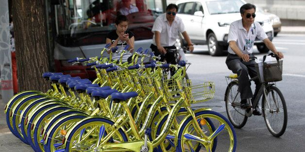 BEIJING, CHINA - JUNE 08: Golden sharing bikes of a bike-sharing service are available on the street...