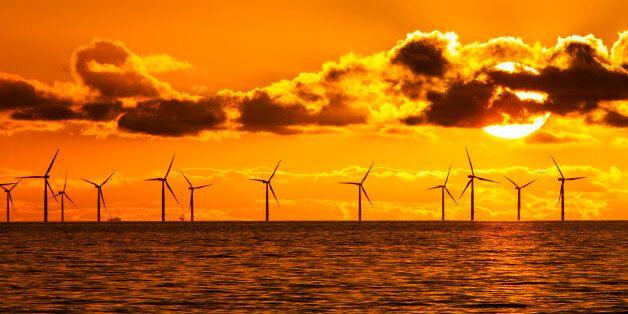 MORECAMBE BAY, UNITED KINGDOM - FEBRUARY 06: Sunset over the Walney offshore Wind farm from Walney island...