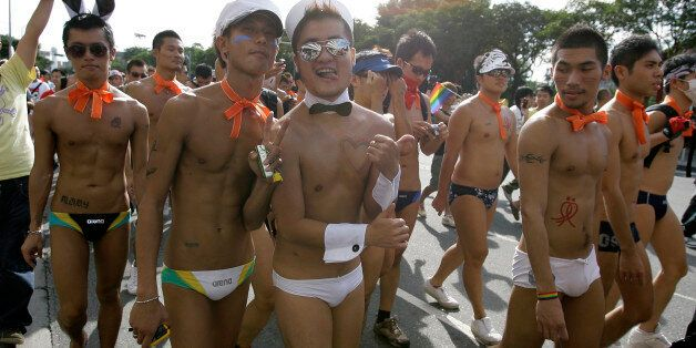 Participants attend the Taiwan Gay Pride Parade in Taipei October 31, 2009. Around 25,000 Taiwanese gathered...