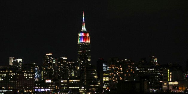 NEW YORK, NY - JUNE 25: View of the Empire State Building illuminated with rainbow colors in honor of...