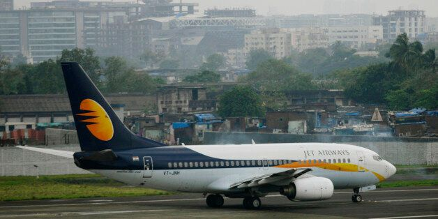 A Jet Airways aircraft waits for take off on the tarmac at the airport in Mumbai September 13, 2009....