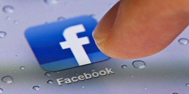 Hong Kong,China - July 2, 2011: Macro image of clicking the Facebook icon on an iPad