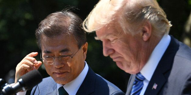 US President Donald Trump (R) and South Korean President Moon Jae-in look on during a joint press conference...