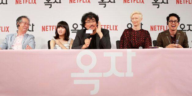 SEOUL, SOUTH KOREA - JUNE 14: Bong Joon Ho(c), Byun Heebong, An Seo Hyun, Tilda Swinton and Steven Yeun...