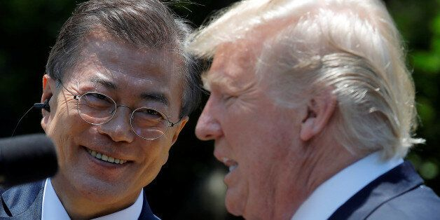 South Korean President Moon Jae-in looks at U.S. President Donald Trump after delivering a joint statement...