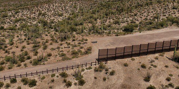 View of the metal fence along the border in Sonoyta, Sonora state, northern Mexico, between the Altar...