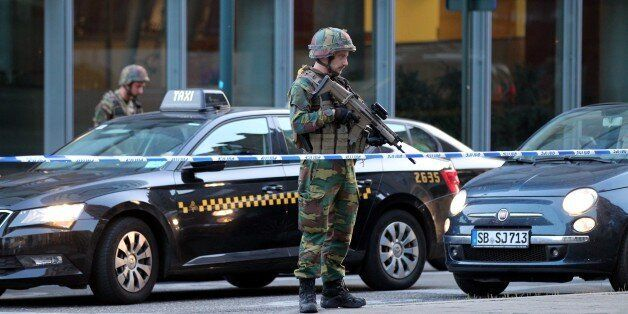 BELGIUM, BRUSSELS - JUNE 20 : Armed soldiers stand guard outside of the Brussels Central Station after...