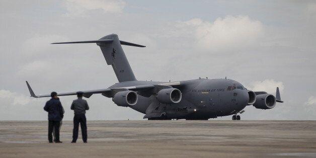 A Royal Australian Air Force (RAAF) C-17 Globemaster III transport plane carrying donated aid for Myanmar's...
