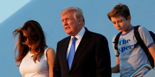 U.S. President Donald Trump with First Lady Melania Trump and their son Barron arrive at Joint Base Andrews...