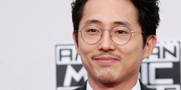 Actor Steven Yeun arrives at the 2016 American Music Awards in Los Angeles, California, U.S., November...