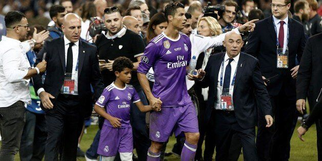 CARDIFF, WALES - JUNE 3: Real Madrid's Cristiano Ronaldo celebrates with his son Cristiano JR. after...