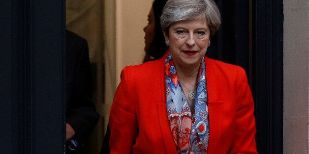 Britain's Prime Minister Theresa May leaves the Conservative Party's Headquarters after Britain's election...
