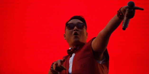 South Korean rapper Psy performs during a public screening before the 2014 World Cup Group H soccer match...