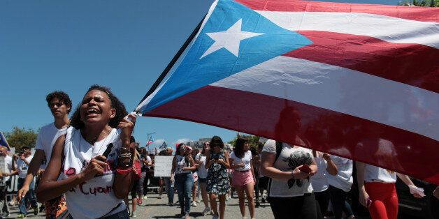 Students of the University of Puerto Rico protest as a meeting of the Financial Oversight and Management...