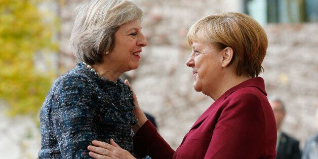 Britain's Prime Minister Theresa May is welcomed by German Chancellor Angela Merkel upon her arrival...