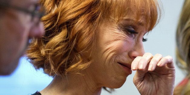 Comedian Kathy Griffin (C) cries during a news conference in Woodland Hills, Los Angeles, California,...