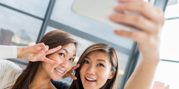 Asian women taking a selfie with a mobile