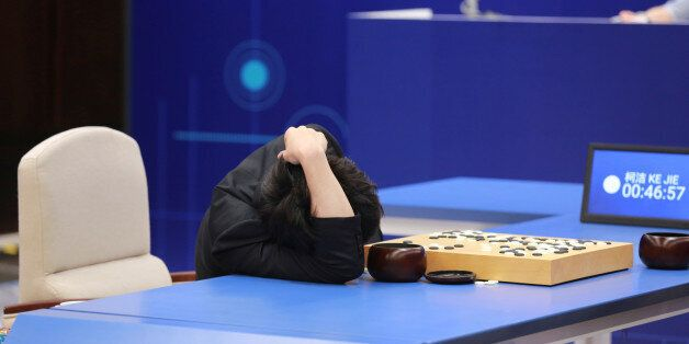 Chinese Go player Ke Jie reacts during his second match against Google's artificial intelligence program...