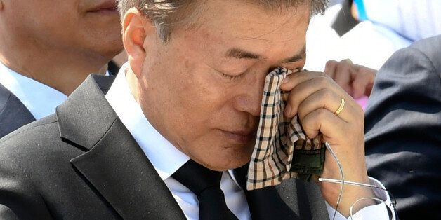 South Korean President Moon Jae-in wipes a tear from his eyes during the annual Democratic uprising memorial...
